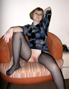 Sexy housewife in black stocking..