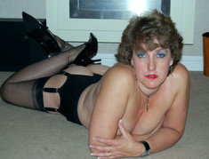 Housewife posing in black stockings..