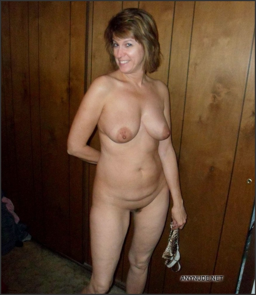 Mature nude woman public